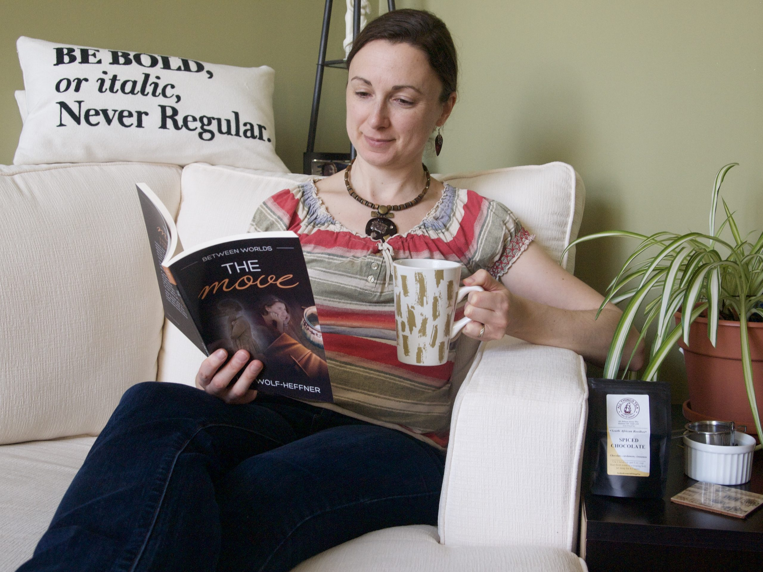 Lori Wolf-Heffner reading one of her books. Her series Between Worlds is free from explicit content.